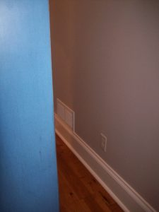 old wall color with armoire in front